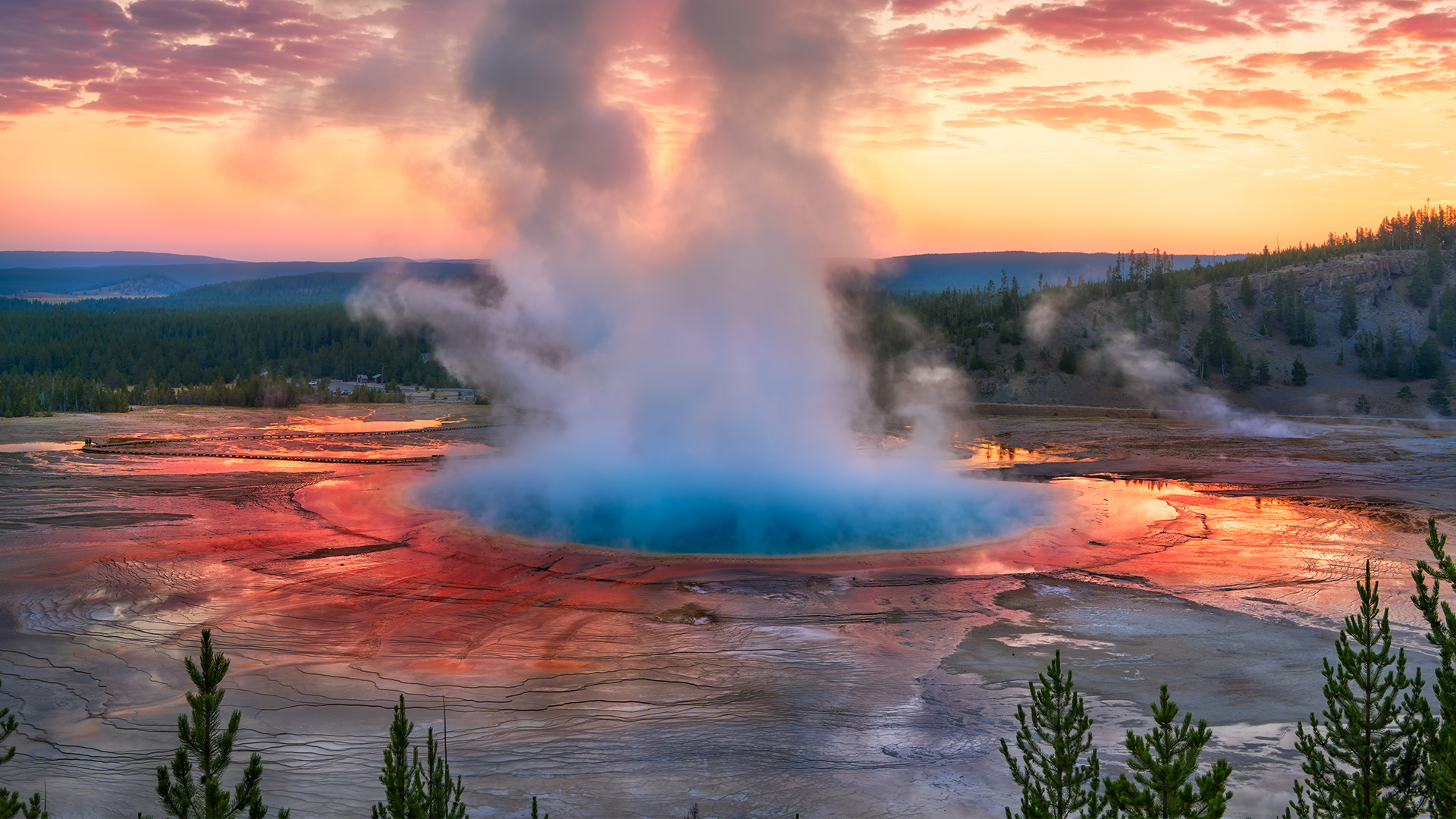 Old Faithful steaming at dawn